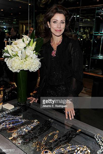 Jewelry designer Angela TassoniNewley poses with her work at 'A Parisian Afternoon' hosted by The House of Lloyd Klein Couture on March 24 2010 in...