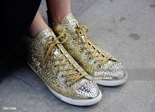 Jewelry designer Emily Kammeyer is seen outside the Jen Kao show wearing Miu Miu sneakers on September 7 2013 in New York City