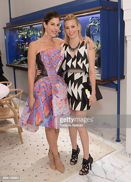 Jewelry designer Irene Neuwirth and actress Elizabeth Banks attend the Irene Neuwirth Flagship Grand Opening on October 30 2014 in West Hollywood...