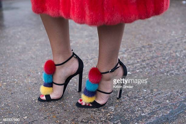 Jewelry designer Natashe Zinko wears a Dior coat Brian Atwood shoes on day 2 of Paris Haute Couture Fashion Week Spring/Summer 2015 on January 26...