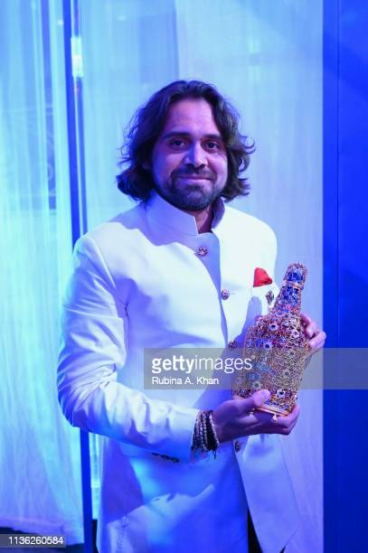 Jewelry designer Siddharth Kasliwal holds a bejeweled Chivas 18 bottle he designed at the third edition of Chivas 18 Alchemy 2019 on March 16 2019 in...