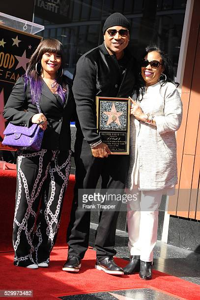 Jewelry designer Simone Smith rapperactor LL Cool J and and Ondrea Smith pose at the ceremony that honored him with a Star on the Hollywood Walk of...