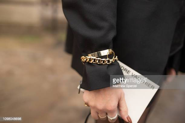 Jewelry detail as a guest is seen on the street attending ALEXANDRE VAUTHIER during Paris Haute Couture Fashion Week wearing gold bracelet on January...