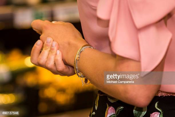 jewelry detail of crown Princess Victoria of Sweden is seen at Paradiset an organic grocery store on May 30 2017 in Stockholm Sweden