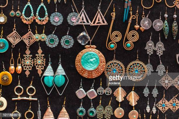 jewelry necklaces and earrings for sale on flea market - jewellery products stock photos and pictures
