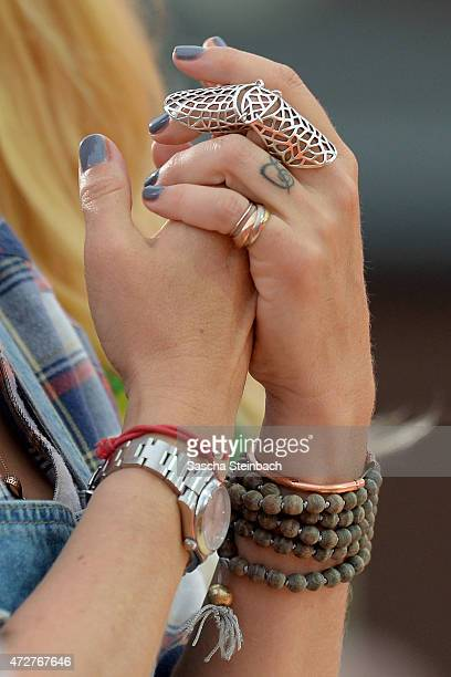 Jewelry of Janine Kunze is seen during the taping of the tv show 'Abenteuer Grillen Der kabel eins BBQKing 2015' on May 9 2015 in Bottrop Germany The...