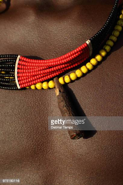 Jewelry on upper body of young tribal Hamer boy, Ethiopia