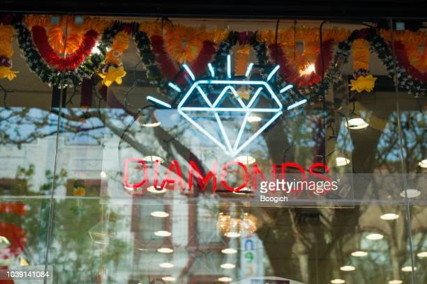 jewelry shop sign advertising diamonds for sale nyc jackson heights queens - diamond jackson stock pictures, royalty-free photos & images