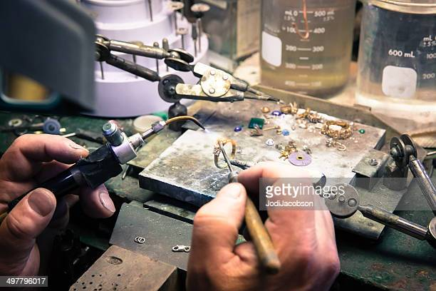 jewelry store employee repairing a ring - jeweller stock photos and pictures