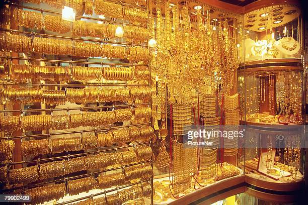 jewelry store filled with gold - gold belt stock pictures, royalty-free photos & images