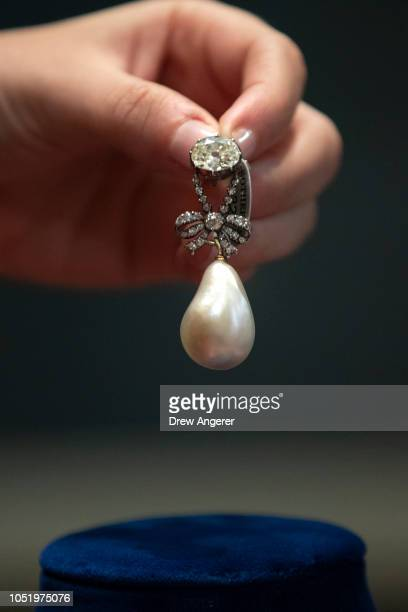 Jewelry worn by French Queen Marie Antoinette including the pearl and diamond pendant shown here is displayed at Sotheby's auction house October 12...