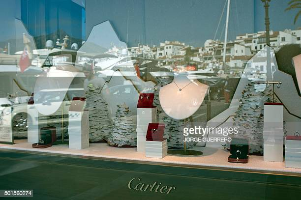Jewels at a Cartier store are showcased in Puerto Banus near Marbella on November 21 2015 The number of millionaires in Spain defined as having a...