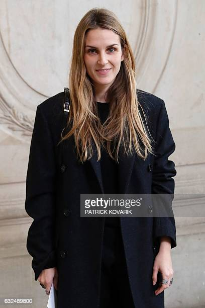 Jewels designer Gaia Repossi poses before the Christian Dior 2017 spring/summer Haute Couture collection on January 23, 2017 in Paris. / AFP /...