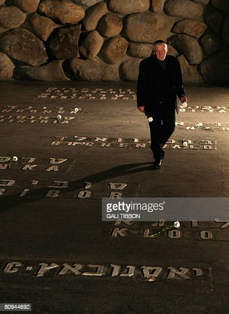 Jewish Australian Holocaust survivor Solomon Susskind who was saved by Oskar Schindler's list places a flower at the Hall of Remembrance where the...