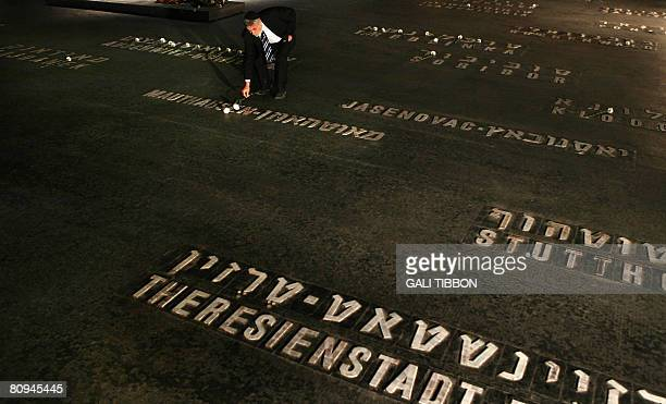 Jewish Australian Holocaust survivor Solomon Susskind who was saved by Oscar Schindler's list places a flower at the Hall of Remembrance where the...