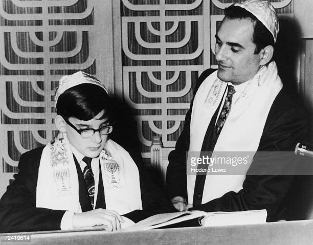 A Jewish boy celebrates his Bar Mitzvah or comingofage soon after his 13th birthday circa 1960