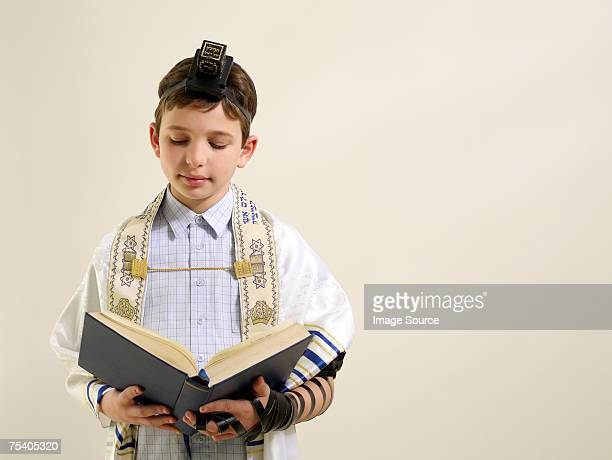 Jewish boy reading from siddur