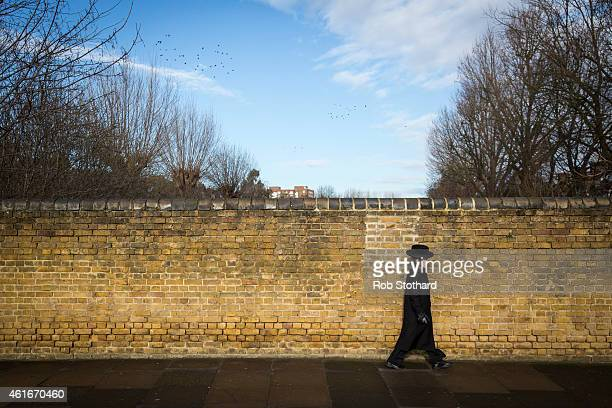 Jewish boy walks across a bridge in the Stamford Hill area on January 17 2015 in London England Police have announced they will increase patrols in...