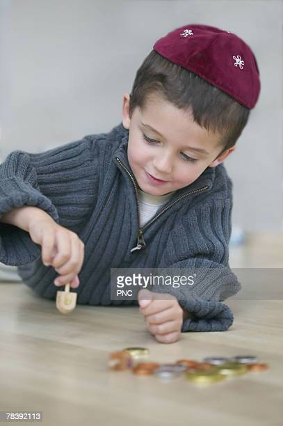 jewish boy with dreidel - dreidel stock photos and pictures