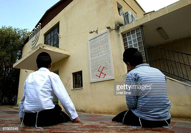 Jewish boys look at antiSemitic graffiti which was sprayed on the walls of a synagogue March 5 2006 in Petah Tikva near Tel Aviv in central Israel...