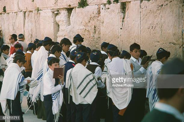 Jewish boys praying at the Western Wall or Wailing Wall in Jerusalem circa 1970 They are wearing the tallit a Jewish prayer shawl