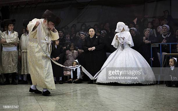 A Jewish bride dances with her grandfather the Rabbi of the ultraOrthodox Jewish group Tholdot Avraham Yizhak Hasidic during her wedding in Mea...