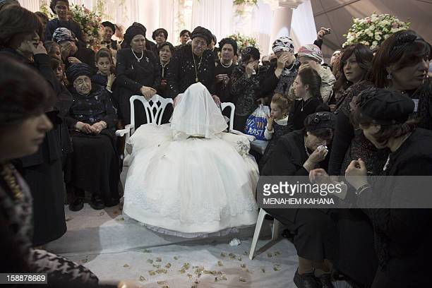 A Jewish bride is surrounded by relatives during her wedding to the greatgrandson of the Rabbi of the Tzanz UltraOrthodox Hasidic community in...