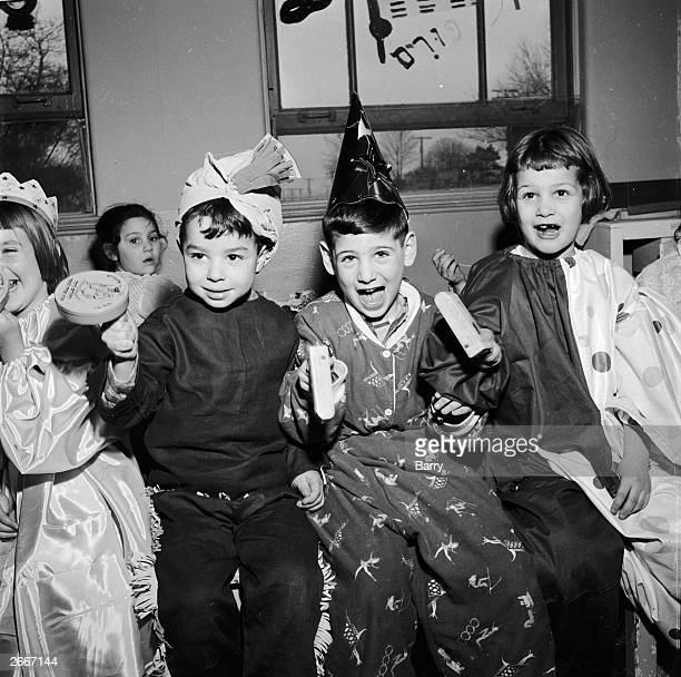 Jewish children celebrating the spring festival of Purim It is marked by the festive reading in the synagogue of the Megillah