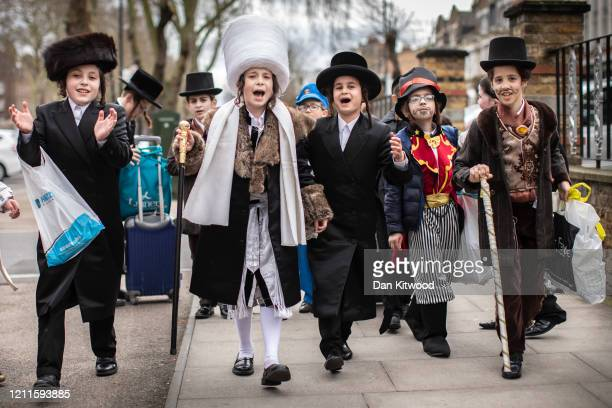 Jewish children dance down the street during the annual Jewish holiday of Purim on March 10 2020 in London England Purim is celebrated by Jewish...