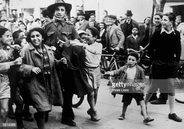 Jewish children from Tel Aviv enthusiastically greet a newly landed Australian soldier of the UN forces