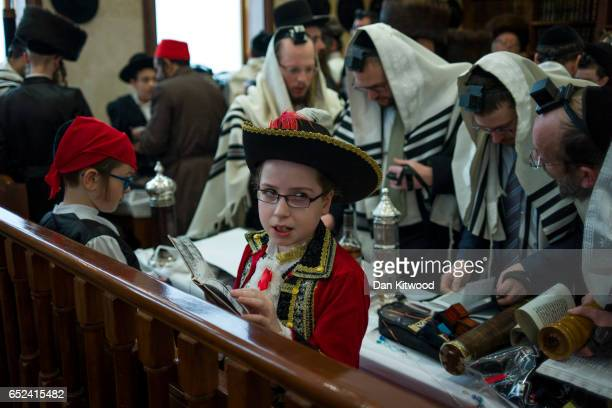 Jewish children in fancy dress at Synagogue during the annual Jewish holiday of Purim on March 12 2017 in London England Purim is celebrated by...