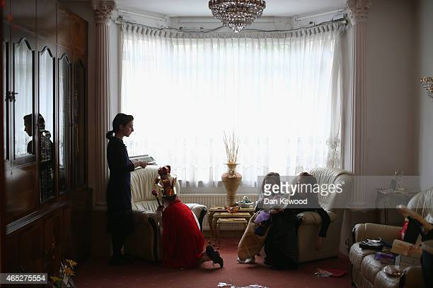 Jewish children in fancy dress relax in their front room during the Jewish holiday of Purim on March 5 2015 in London England The annual Purim...