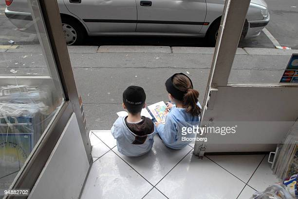 Jewish children sit on the doorstep of a store in the 19th arrondissement of Paris France on Monday July 7 2008 The tightly knit Jewish community in...