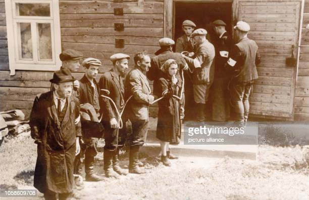 Jewish citizens are arrested by the Lithuanian Home Guard who collaborated with the German occupying forces after the occupation of Lithuania by the...
