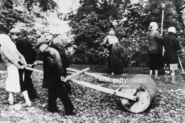 Jewish civilians are forced to pull rollers to repair road damage in Nazioccupied Poland March 1941