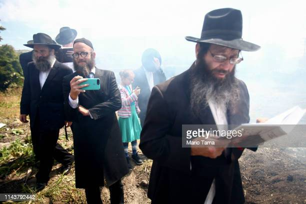 Jewish community member reads a prayer during the traditional burning of chametz or leavened foods facilitated by ChabadLubavitch before the start of...