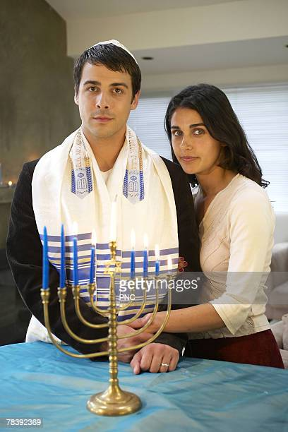 jewish couple with menorah - jewish man stock photos and pictures