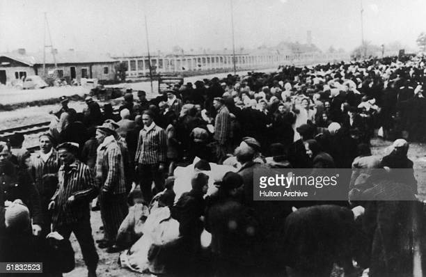 Jewish deportees arriving at the railway terminus at the Nazi concentration camp at Auschwitz Poland circa 1942
