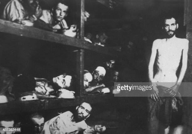 Jewish deportees in the Buchenwald concentration camp pose for a Soviet photographer when the Red Army restaged the liberation of the Nazi's...