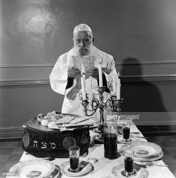 A Jewish elder breaks the Matzoh during the Passover Seder 1961