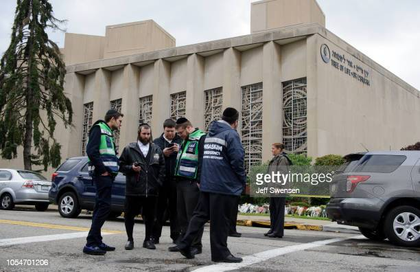 Jewish emergency crew and police officers at the site of the mass shooting that killed 11 people and wounded 6 at the Tree Of Life Synagogue on...