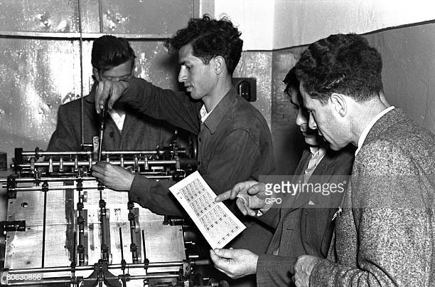 Jewish experts examine stamps printed on what was prior to independence an illegal printing press on May 16 in Tel Aviv in the 2dayold state of Israel