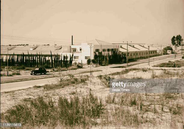 Jewish factories in Palestine on Plain of Sharon along the coast to Haifa The Lodzia Textile Co in Holon settlement Closer view of factory 1934...