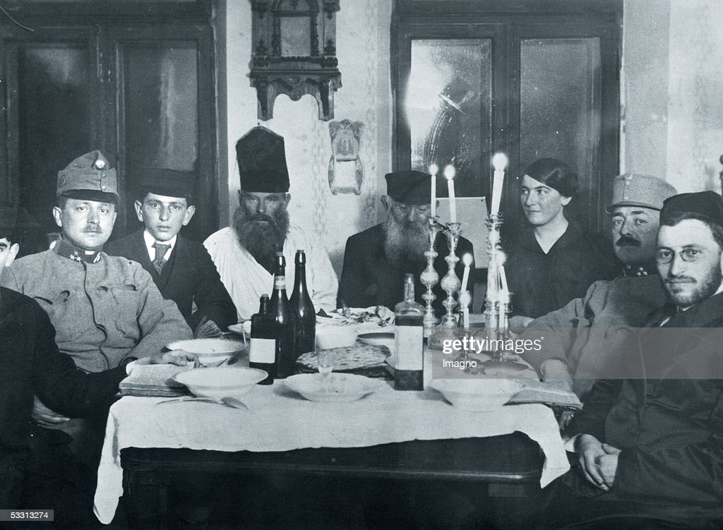 jewish family from galicia celebrating pesach at the family table