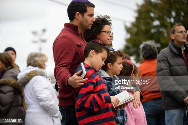 Jewish family pauses in front of at a memorial for victims of the mass shooting that killed 11 people and wounded 6 at the Tree Of Life Synagogue on...