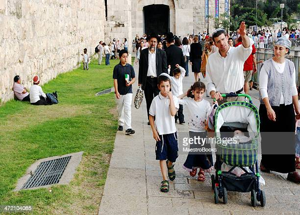 Jewish family walking by the Old City of Jerusalem