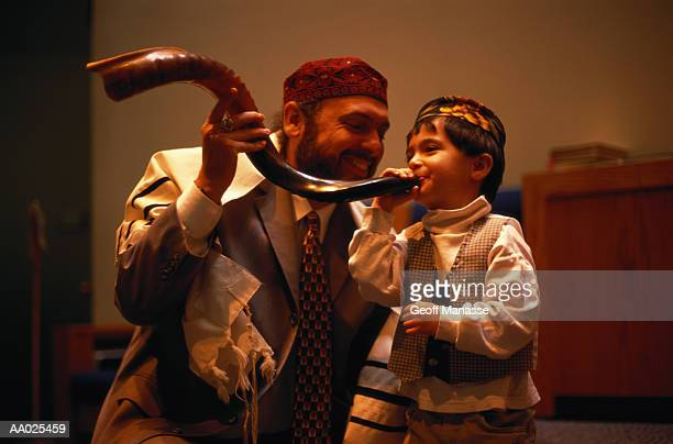 jewish father and son with a shofar - jewish prayer shawl stock pictures, royalty-free photos & images