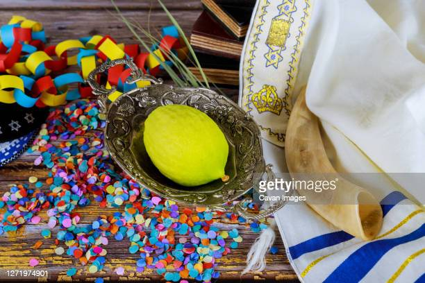 jewish festival of sukkoth over paper colorful chain garland on kippah - 仮庵の祭り ストックフォトと画像