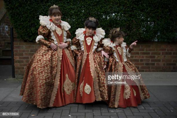 Jewish girls in fancy dress stand outside their home during the annual Jewish holiday of Purim on March 12 2017 in London England Purim is celebrated...