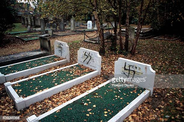 jewish graves desecrated with nazi symbols - nazi swastika stock pictures, royalty-free photos & images